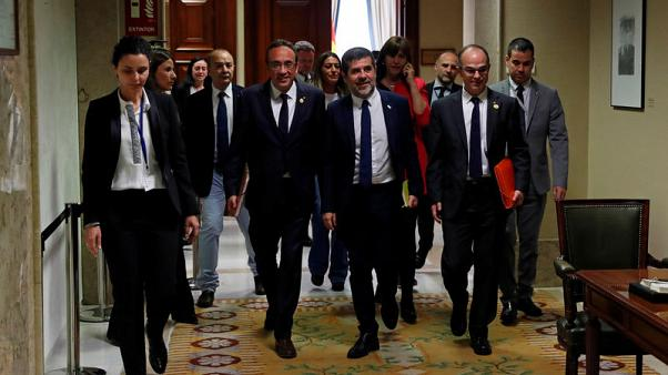 Jailed Catalan separatist MPs pick up credentials amid tight security