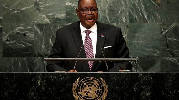 Malawians vote in tough election for President Mutharika