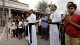 In tearful ceremony, Sri Lanka Catholics mark one month since bombings