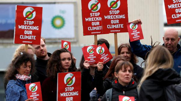 Climate protesters disrupt BP investor meeting, Shell gets boost