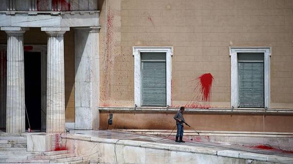 Attackers throw red paint at Greece's parliament