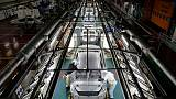 Japan manufacturers' mood up, tax hike still in doubt - Reuters Tankan