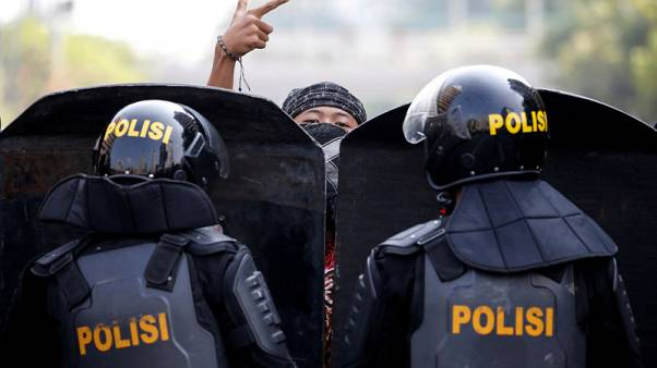 Six die, protests swell as Indonesia plunges into post-election unrest