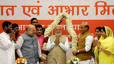 Modi's party promises to boost India's economy; Congress calls exit polls fake