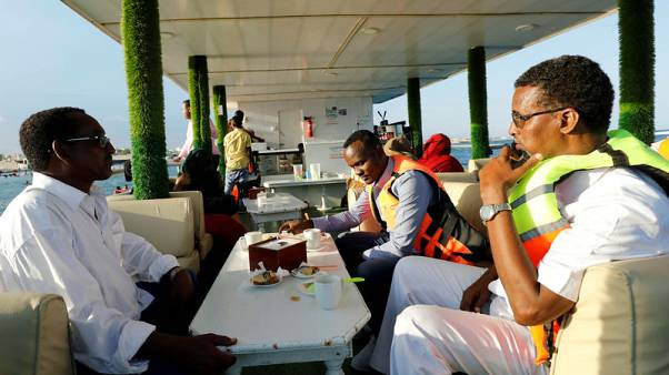 Somalis escape to the beach and a new floating restaurant