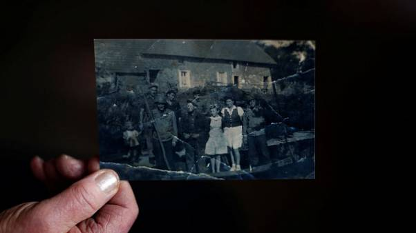 "In western France, a village remembers D-Day's ""secret massacre"""