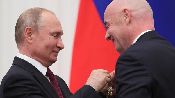Putin honours FIFA's Infantino with state medal over 2018 World Cup