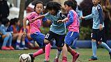 Petites filles lors d'un entraînement de foot, à Shanghai, le 30 avril 2019