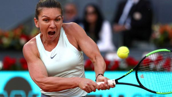 Halep to start French Open title defence with no extra pressure