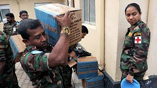Sri Lankan peacekeepers share time, meals and other gifts with patients at Bor hospital (Gideon Sackitey)