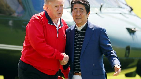 With trade differences in the background, Trump and Abe do diplomacy over golf and sumo
