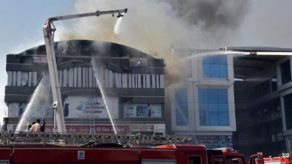 Two Indian fire officials suspended after coaching centre blaze kills 22