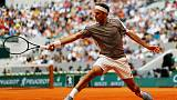 Tennis - Federer graces new-look Roland Garros with stylish opening win