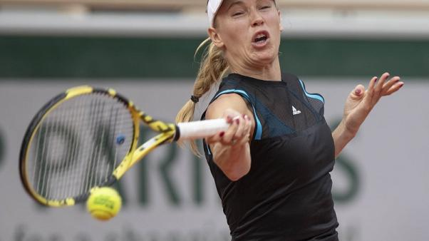 Fragile Wozniacki another top casualty in Paris