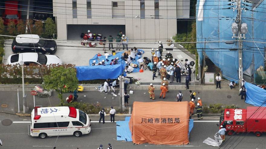 Two have been killed in a stabbing in Japan which has wounded 13 schoolgirls