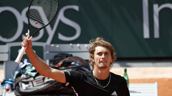 Zverev digs deep to reach French Open round two