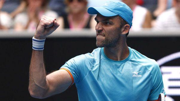 Tennis - Karlovic, 40, beats Lopez in oldest match
