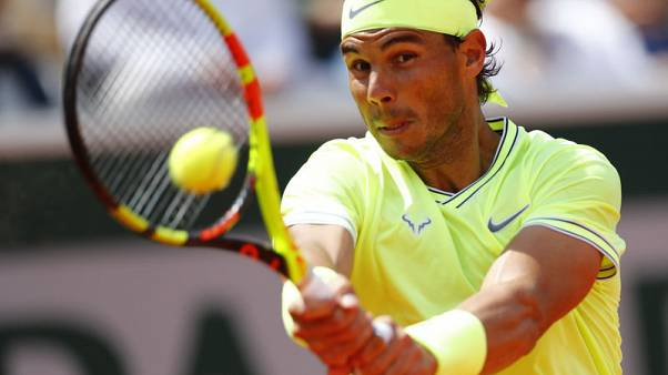 Brutal Nadal through to French Open third round