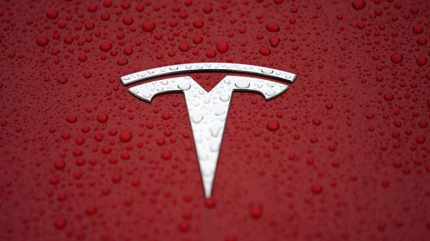 Tesla CEO urges employees to 'catch up' to hit delivery record