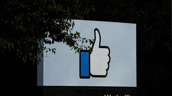 Inflatable angry emoji looms over Facebook annual board meeting