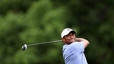 Woods shoots 70 as Moore takes clubhouse lead at Memorial