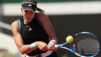 Muguruza powers past Svitolina into French Open fourth round