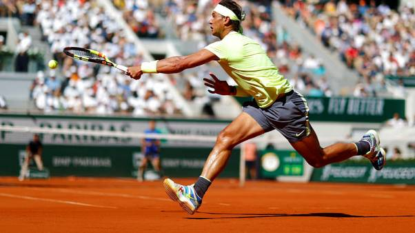 Nadal drops set but powers past Goffin