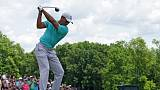 Double bogey derails Woods as Rose moves into contention