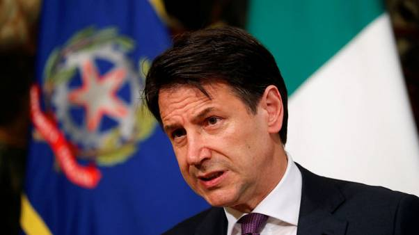 Italy PM threatens to quit, tells warring coalition to end feud
