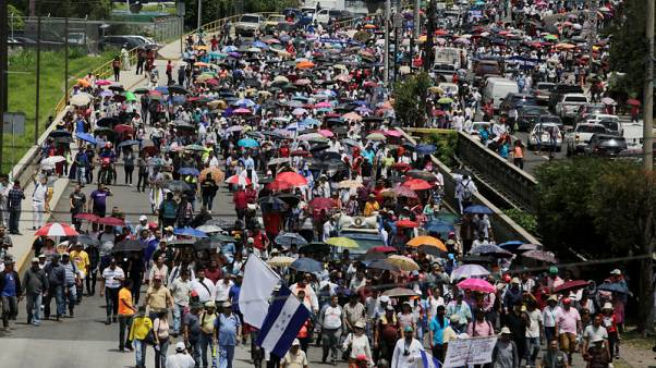 Protesters return to streets in Honduras, despite president's concessions