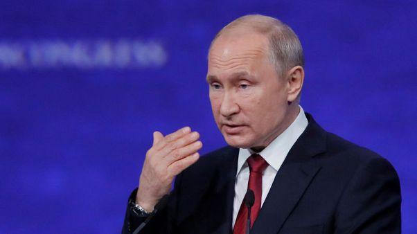 بوتين يقف مع الصين وينتقد الولايات المتحدة بشأن التجارة وهواوي