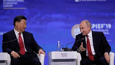 Putin stands by China, criticises U.S., in trade, Huawei disputes