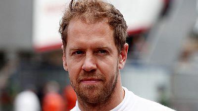 Vettel puts Ferrari on top in final practice