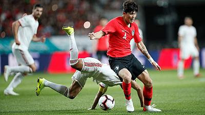Kim own goal earns Wilmots' Iran draw with Koreans