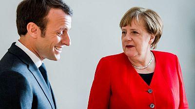 Macron says he would back Merkel if she runs for EU leadership