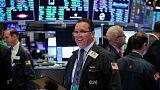 الأسهم الأمريكية تغلق شبه مستقرة عقب موجة صعود
