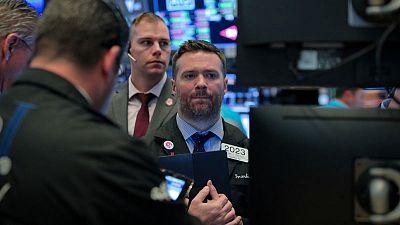 Stock edge lower, gold gains on slowdown, geopolitical fears