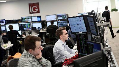 Heavyweight financials, exporter stocks drag FTSE 100 lower