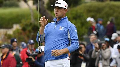 Golf: Woodland holds nerve to stay top at U.S. Open