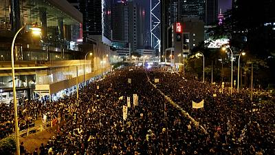 Hong Kong leader says sorry as protesters insist she quits