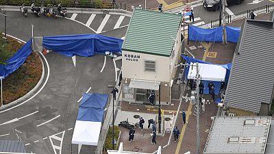 Japan arrests man for stabbing police officer, taking gun