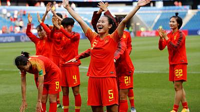 China and Spain through to last 16 after goalless draw