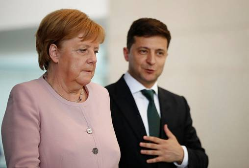 Merkel says recovered from shaking bout after drinking water