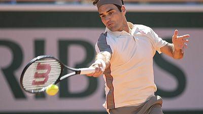 Federer begins grasscourt season with win over Millman in Halle
