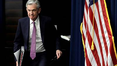 Fed holds rates steady, signals cuts possible later this year