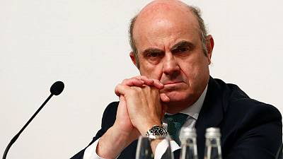 Risks are tilted to downside and ECB will act if they materialise - de Guindos