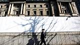 BOJ holds fire on policy, joins Fed in warning of mounting global risks