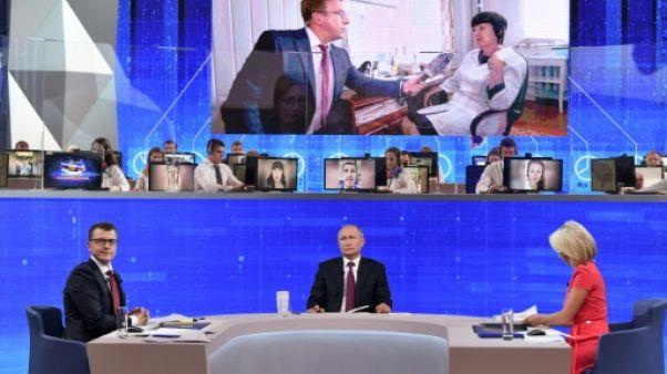 Le président russe Vladimir Poutine lors de de sa traditionnelle session de doléances en direct à la télévision, le 20 juin 2019 à Moscou