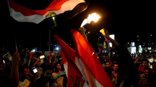 Les Egyptiens en liesse dans les rues du Caire, après la victoire de leur équipe sur le Zimbabwe en match d'ouverture de la CAN, le 21 juin 2019
