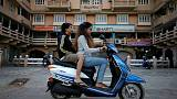 India asks scooter, bike makers to draw up plan for EVs - sources